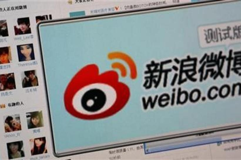 The logo of Sina Corp's Chinese microblog website ''Weibo'' is seen on a screen in this photo illustration taken in Beijing September 13, 2011.