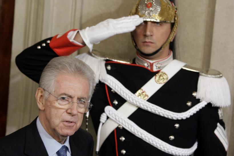 Italian Prime Minister designate Mario Monti arrives to talk to reporters at the end of a meeting with Italian President Giorgio Napolitano at the Quirinale Palace in Rome