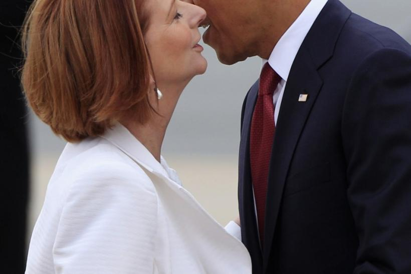 U.S. President Obama kisses Australian Prime Minister Gillard as he arrives in Canberra