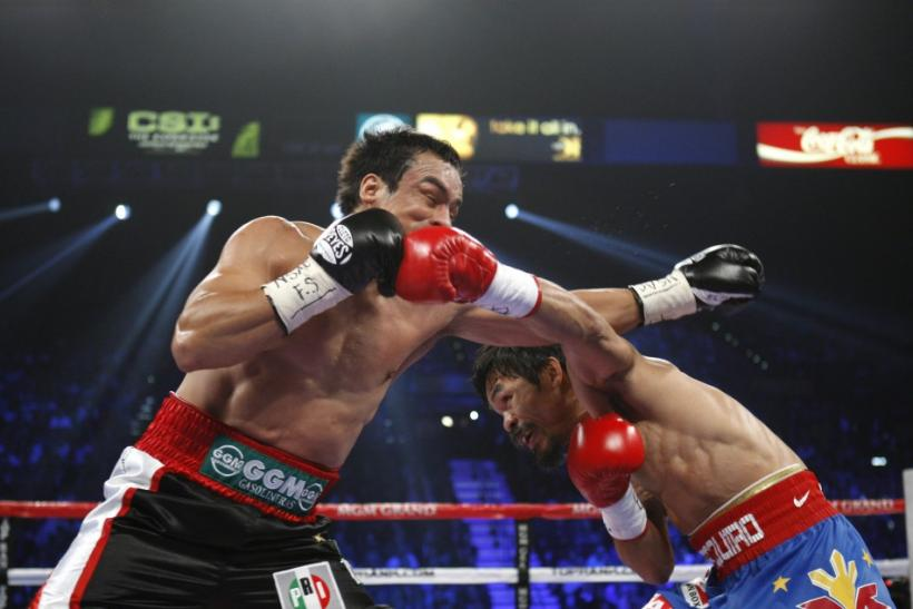 Marquez of Mexico battles it out with Pacquiao of the Philippines during their WBO welterweight fight at the MGM Grand Garden Arena in Las Vegas