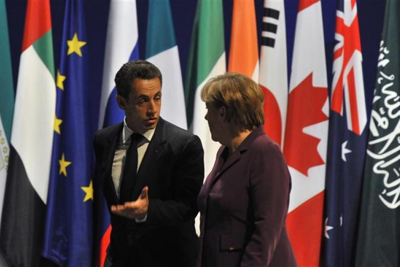 France's President Sarkozy and Germany's Chancellor Merkel leave a joint press conference after crisis talks on the eve of a G20 summit of major world economies in Cannes