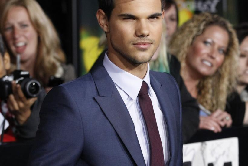 "Cast member Taylor Lautner poses at the premiere of ""The Twilight Saga: Breaking Dawn - Part 1"" at Nokia Theatre in Los Angeles"