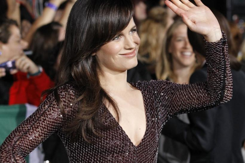 "Cast member Elizabeth Reaser waves at the premiere of ""The Twilight Saga: Breaking Dawn - Part 1"" at Nokia Theatre in Los Angeles"
