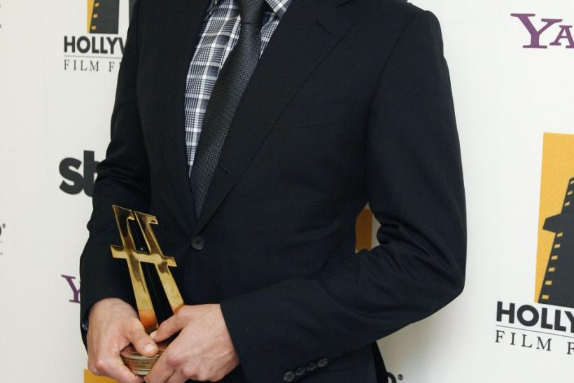 Cooper poses after accepting the Comedy Award at the 13th annual Hollywood Awards gala in Beverly Hills