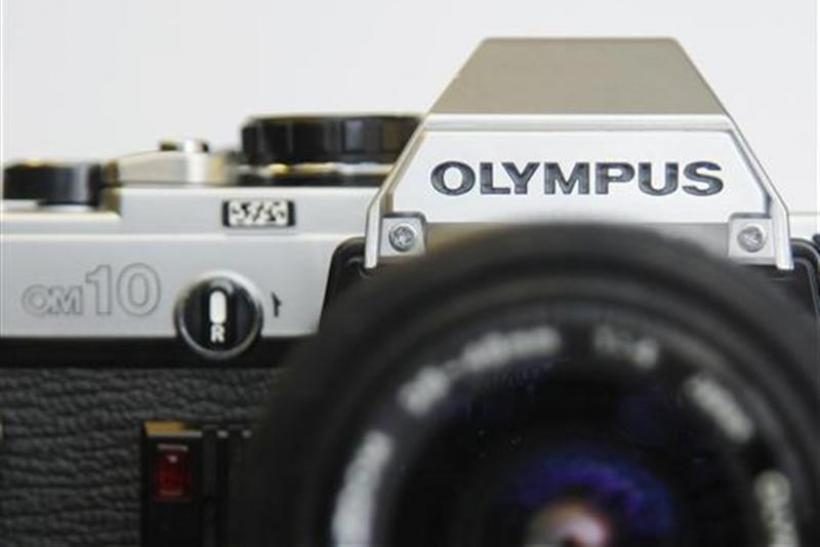 An Olympus OM10 35mm film camera is seen in a used camera shop in London