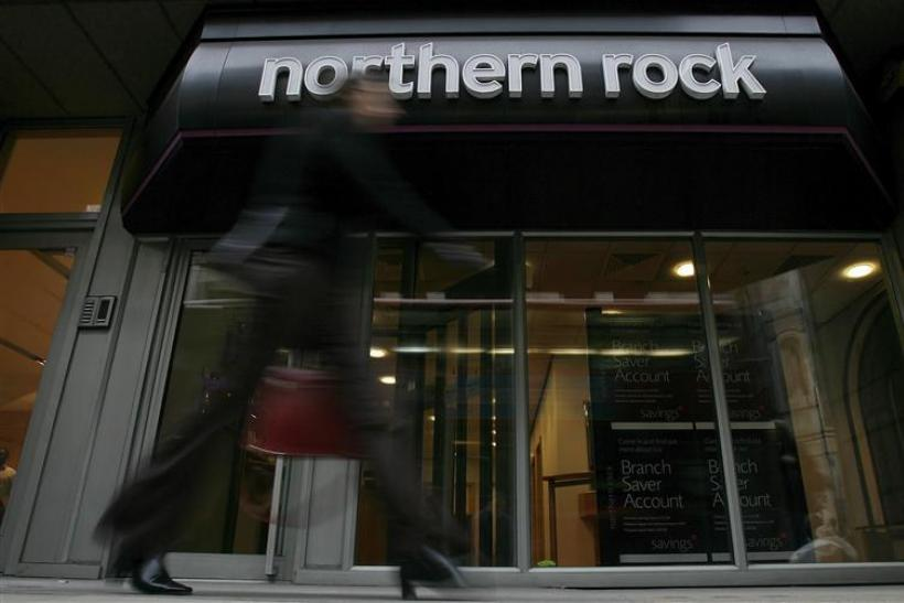 A pedestrian walks past a branch of the Northern Rock bank in the City of London