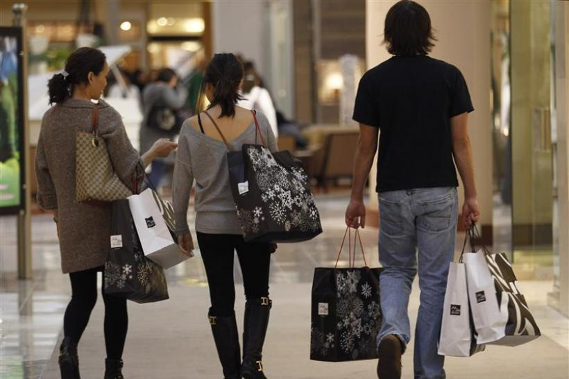 Shoppers carry their purchases during the Black Friday sales at a shopping mall in Tysons Corner