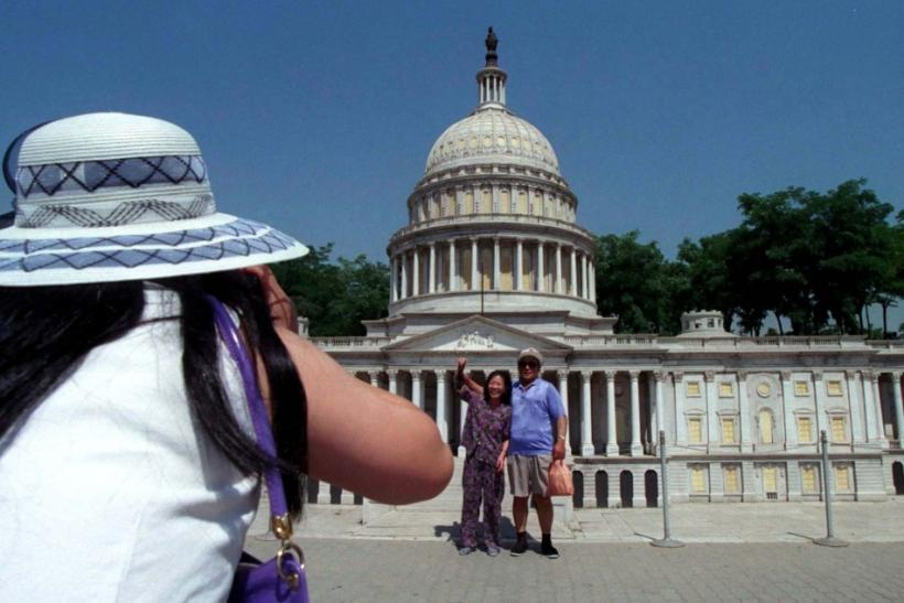 Chinese Tourists Take Photos in front of Capital Building Replica in Beijing