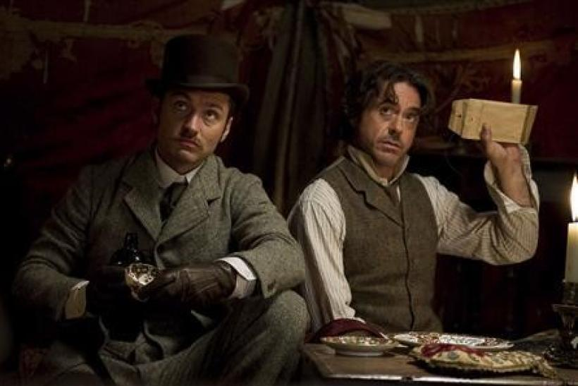 "Actors Jude Law, as Dr. Watson, and Robert Downey Jr., as Sherlock Holmes, are shown in a scene from the new Warner Bros. Pictures' action adventure mystery ""Sherlock Holmes: A Game Of Shadows"", in this undated publicity handout. The period"