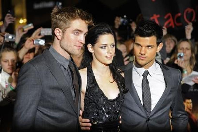 Actors Robert Pattinson (L), Kristen Stewart (C) and Taylor Lautner arrive for the British premiere of 'The Twilight Saga: Breaking Dawn' at Westfield in east London