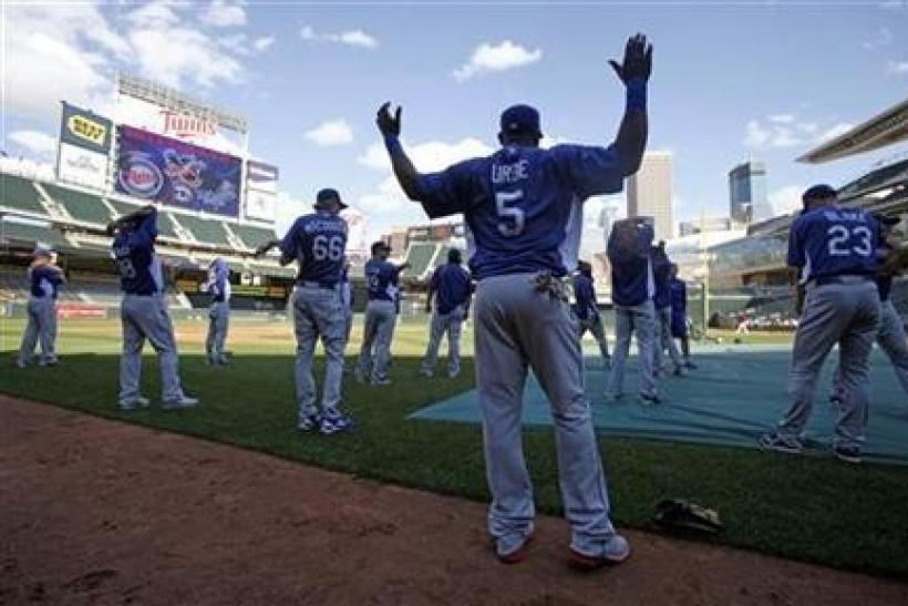 Los Angeles Dodgers second baseman Juan Uribe warms up with his teammates before taking batting practice before the start of their American League MLB interleague baseball game at Target Field in Minneapolis