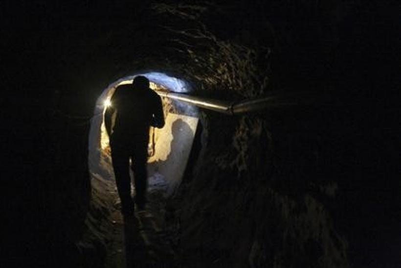 A journalist walks through a tunnel during a presentation to the media in Tijuana