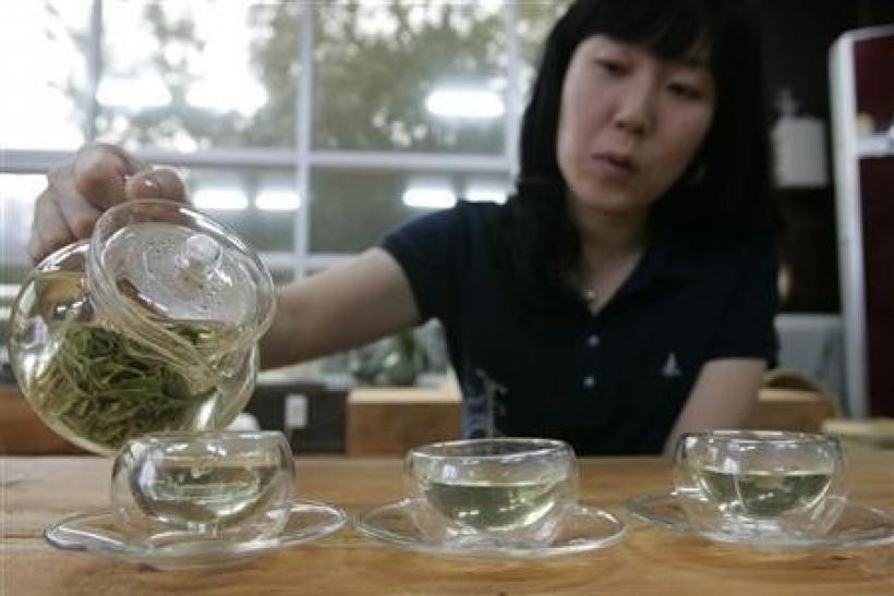 A woman pours hot water to make green tea at a traditional tea house in Boseong, about 397 km (246 miles) south of Seoul