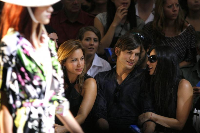 Actors Ashton Kutcher and Demi Moore attend the Diesel Spring 2008 collection during New York Fashion Week