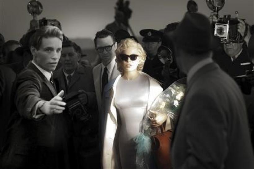 "Actors Eddie Redmayne (L) playing Colin Clark, Dougray Scott playing Arthur Miller, and Michelle Williams (C) playing Marilyn Monroe, are shown in a scene from director Simon Curtis' new film ""My Week With Marilyn"" in this undated publicity"