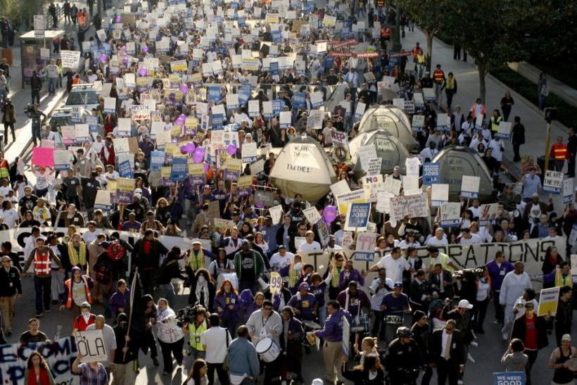 Demonstrators march along 5th St in Downtown Los Angeles on the second month anniversary of the Occupy movement in Los Angeles
