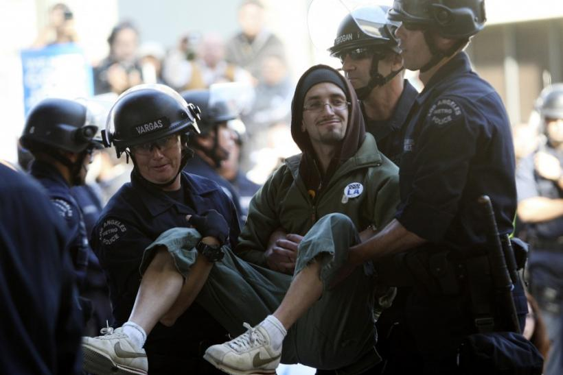 A demonstrator is carried off by members of the Los Angeles Police Department during a planned arrest on the second month anniversary of the Occupy movement in Los Angeles