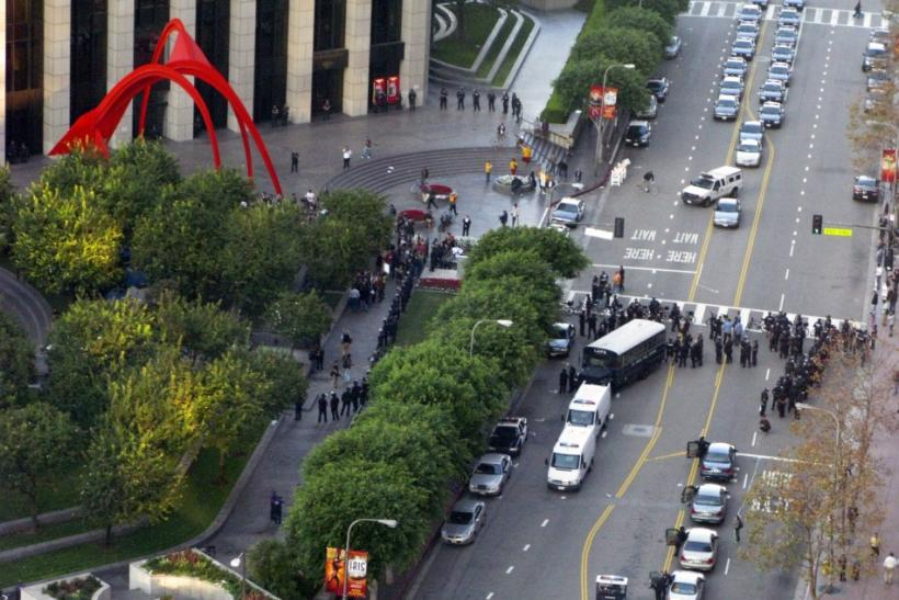 A contingent of Los Angeles Police Department officers gather in the street at the Bank of America Plaza, where Occupy Los Angeles protestor have gathered and threatened to set up tents for the night, in the downtown financial district of Los Angeles, Cal