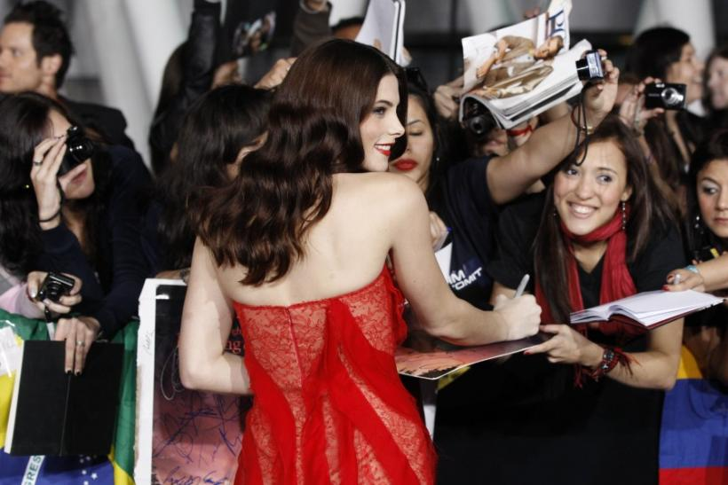 "Cast member Greene signs autographs at the premiere of ""The Twilight Saga: Breaking Dawn - Part 1"" at Nokia Theatre in Los Angeles"