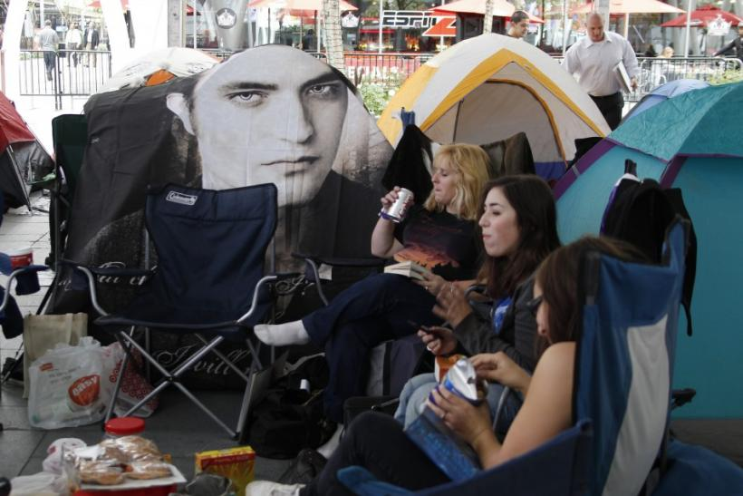 "Image of actor Robert Pattinson covers a tent set up by fans awaiting premiere ""The Twilight Saga: Breaking Dawn - Part 1"" in downtown Los Angeles"