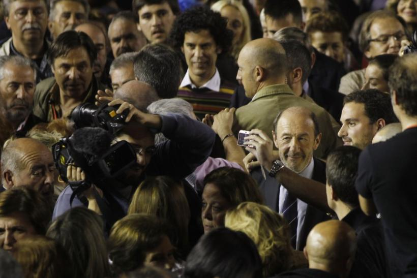 Prime ministerial candidate Perez Rubalcaba of the Spanish Socialist Workers' Party poses with a supporter in Fuenlabrada