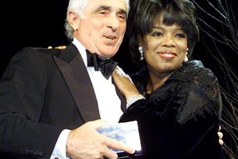 Ted Forstmann is Honored by Oprah Winfrey in New York