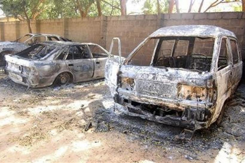 Burnt vehicles are seen at the ECWA church compound in New Jerusalem