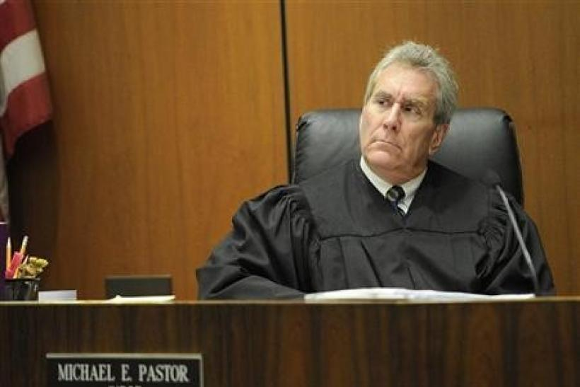 Judge Michael Pastor listens during the redirect cross-examination of Dr. Paul White (not pictured) in Dr. Conrad Murray's trial in the death of pop star Michael Jackson in Los Angeles November 1, 2011.
