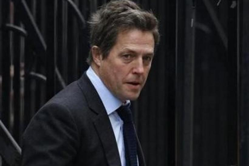 British actor Hugh Grant arrives at the Leveson Inquiry at the High Court in central London, November 21, 2011.
