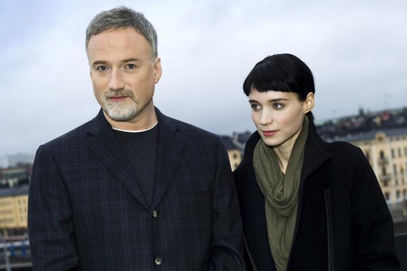Actress Rooney Mara and director David Fincher pose during a press meeting in Stockholm, November 21, 2011. Mara is starring as Lisbeth Salander in the movie 'The Girl with the Dragon Tattoo' which has its premiere in Stockholm on December 13.