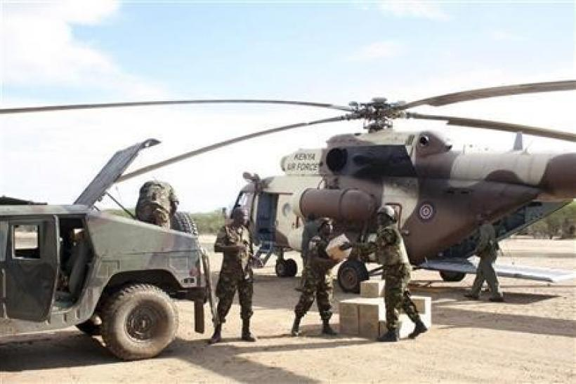 Kenya troops move supplies from a helicopter at the Garrisa airstrip near the Somali-Kenya border