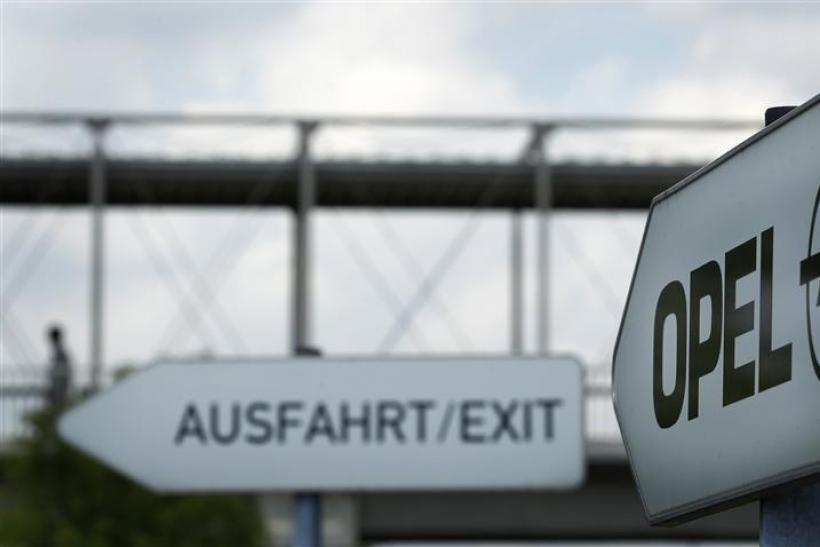Traffic signs leading the way toward the exit of the parking facility outside the headquarters of German car manufacturer Opel in Ruesselsheim