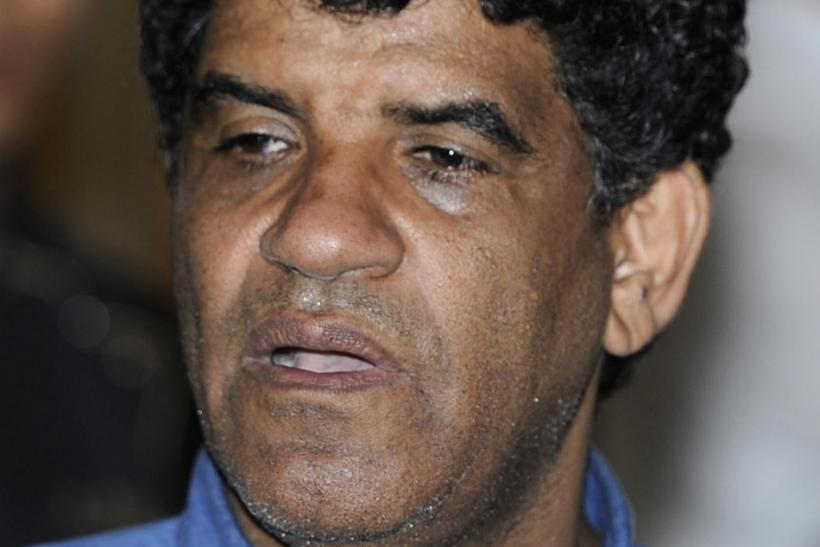 File photo of Senussi, head of the Libyan Intelligence Service, speaking to the media in Tripoli