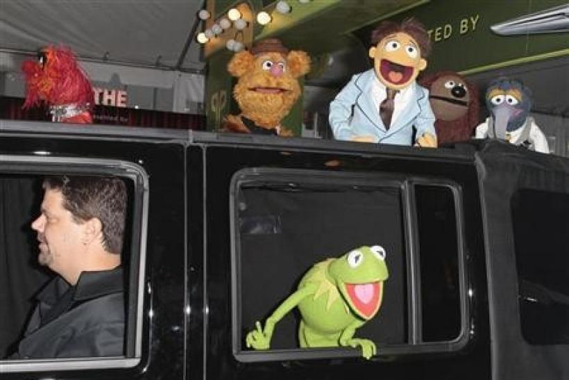 Muppets cast members Kermit the Frog, Animal (top L), Fozzie Bear (2nd L), Walter (3rd L), Rowlf (2nd R), and Gonzo (R) arrive at the ''The Muppets'' world premiere in Hollywood, California