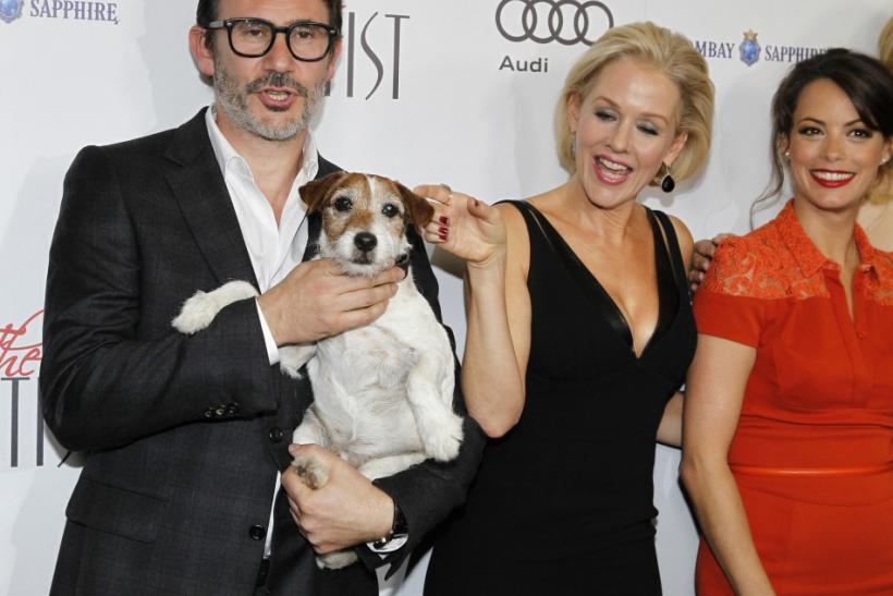 "French director Michel Hazanavicius (L) poses with Uggie the dog and cast members Penelope Ann Miller and Berenice Bejo (R) at a special screening of their film ""The Artist"" in Beverly Hills, California"