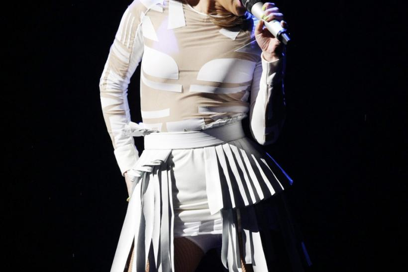 Singer Jennifer Lopez performs with will.i.am (not pictured) at the 2011 American Music Awards in Los Angeles