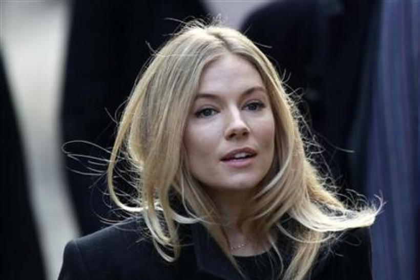 British actress Sienna Miller arrives at the Leveson Inquiry into media practices at the High Court in central London November 24, 2011.