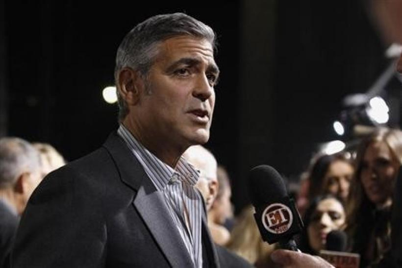 Cast member George Clooney is interviewed at the premiere of ''The Descendants'' at the Samuel Goldwyn Theater in Beverly Hills, California November 15, 2011.