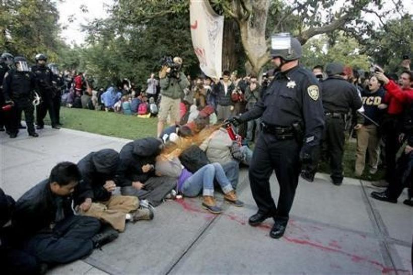 A University of California Davis police officer pepper-sprays students during their sit-in at an ''Occupy UCD'' demonstration in Davis, California November 18, 2011.