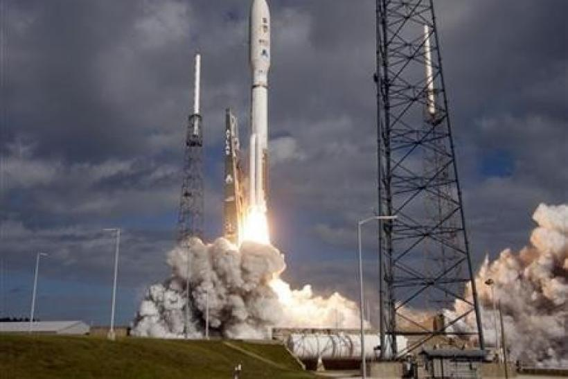 An Atlas 5 rocket lifts off from the launch pad in Cape Canaveral, Florida November 26, 2011.
