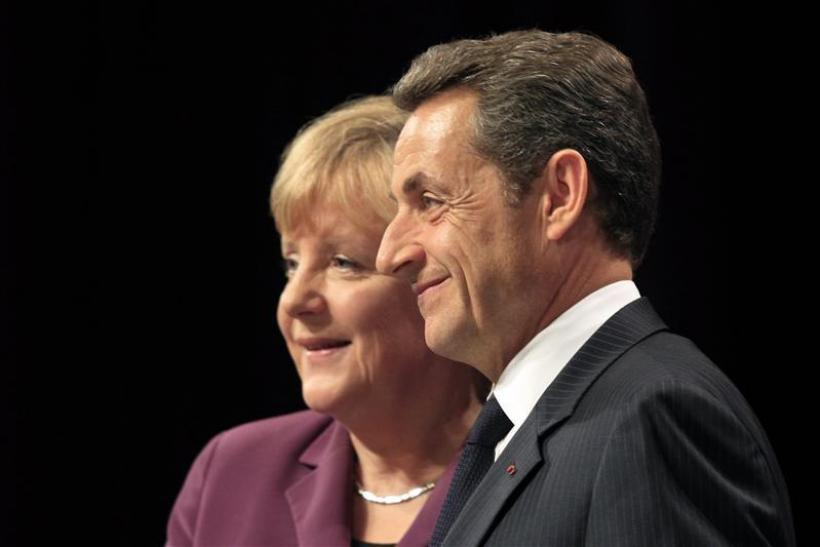 Nicolas Sarkozy (R), the French President, with Angela Merkel, the German Chancellor.