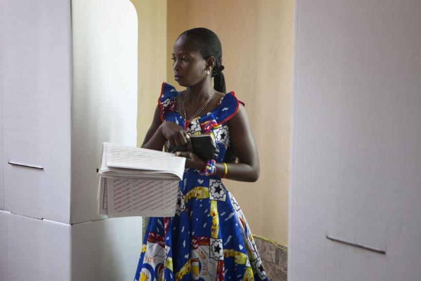 A woman casts her ballot at a polling station in Congo's capital Kinshasa