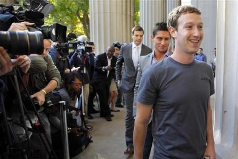 Facebook founder and CEO Mark Zuckerberg walks away after briefly speaking to reporters during a visit to the Massachusetts Institute of Technology in Cambridge, Massachusetts November 7, 2011.