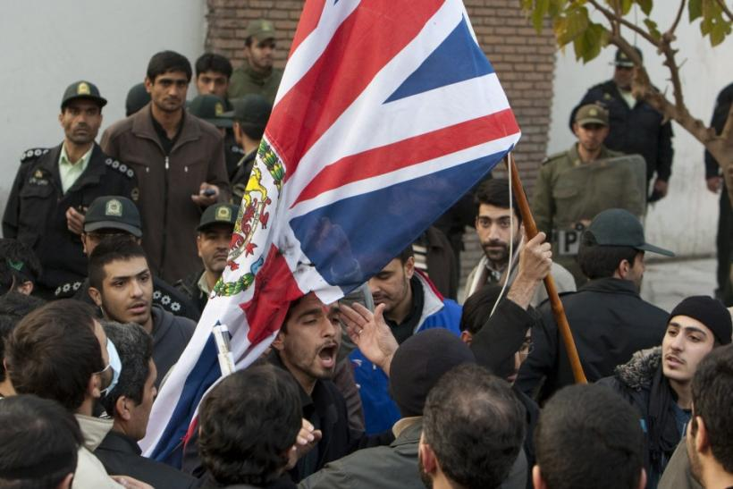 Protestors remove the flag of the British embassy in Tehran