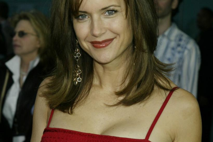 "American actress Kelly Preston, wife of American actor John Travolta, star of the new action thriller film ""The Punisher"" poses at the film's premiere in Hollywood April 12, 2004."