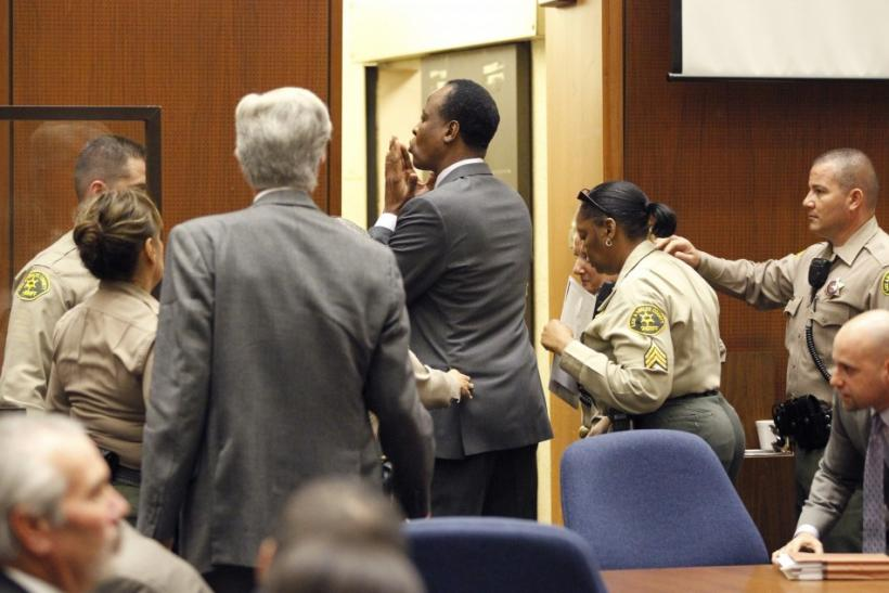 Dr. Conrad Murray blows a kiss to an unidentified member of the courtroom audience after he was sentenced to four years in county jail for his involuntary manslaughter conviction of pop star Michael Jackson