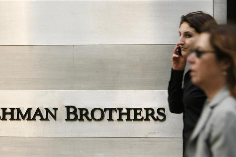 Pedestrians walk past a Lehman Brothers sign in New York