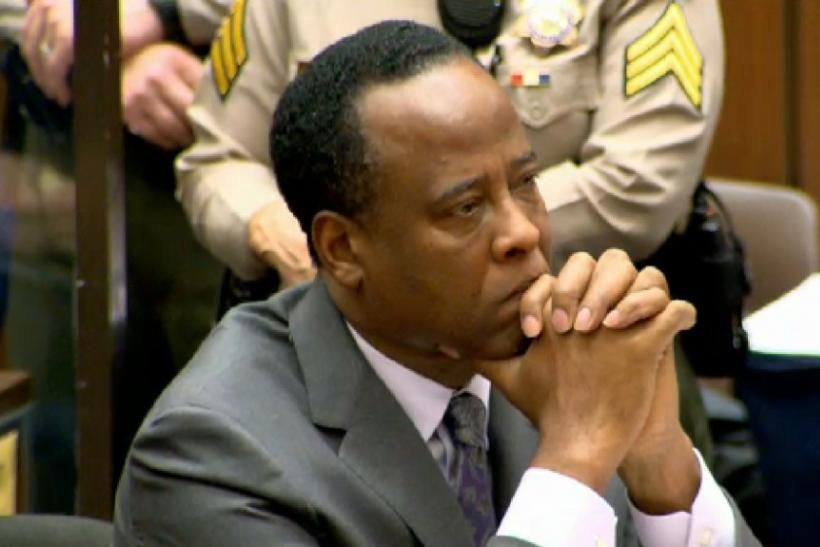 Dr. Conrad Murray listens as Judge Michael Pastor sentences him to four years in county jail for his involuntary manslaughter conviction of pop star Michael Jackson in Los Angeles