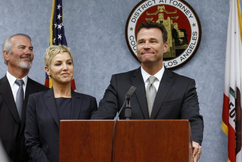 Los Angeles Deputy District Attorney Walgren smiles while speaking to the media after Dr. Murray was sentenced to four years in county jail in Los Angeles