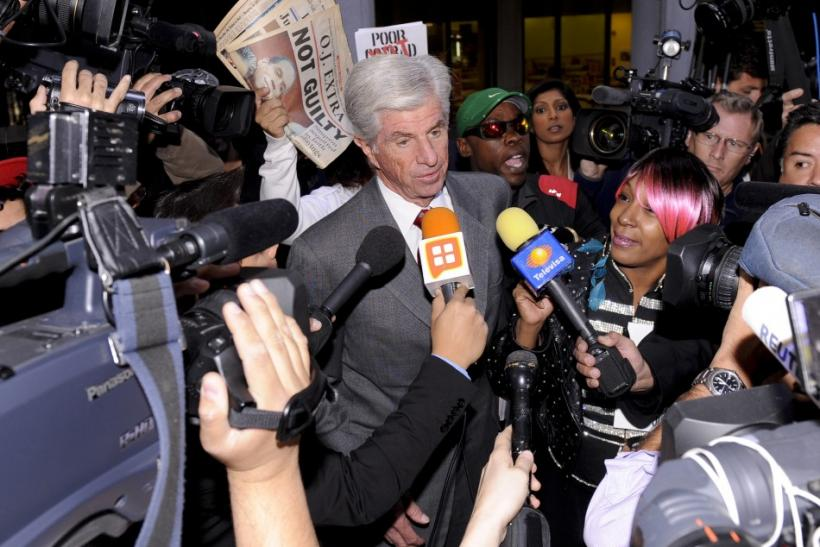 Conrad Murray's attorney J. Michael Flanagan talks with the media as he leaves the sentencing hearing of Dr. Conrad Murray, in Los Angeles